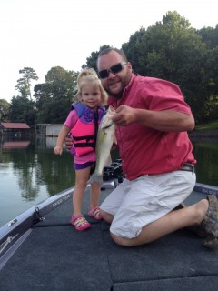 Gwyn catches a big one with her daddy Jesse Smith.