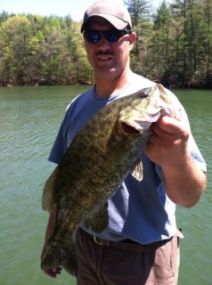 Isreal Gibson, with his not so small, smallmouth bass on Lake James